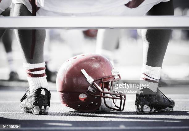 football player on bench with helmet - cleats stock pictures, royalty-free photos & images