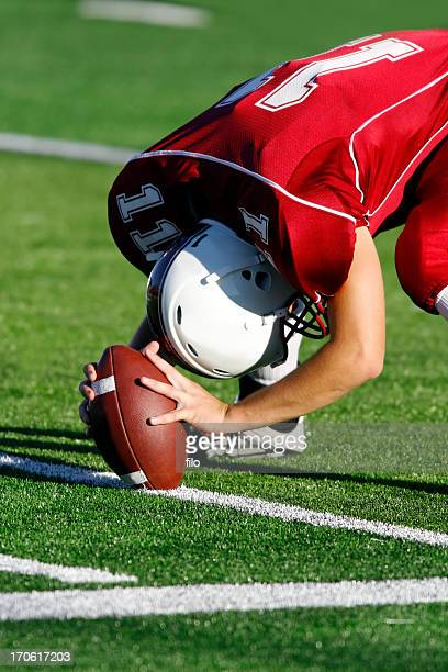 football player on the field - center athlete stock pictures, royalty-free photos & images