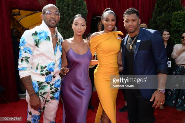 Football player Orlando Scandrick Draya Michele singer Ciara and fooball player Russell Wilson attend the 2018 ESPY Awards Red Carpet Show Live...