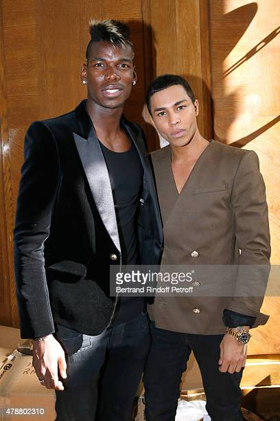 Football Player Paul Pogba and Fashion Designer Olivier Rousteing pose Backstage after the Balmain Menswear Spring/Summer 2016 show as part of Paris...