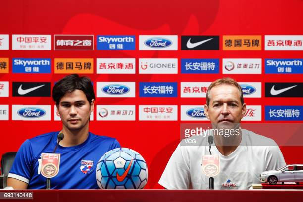 Football player Phil Younghusband and head coach Thomas Dooley of Philippines attend a press conference ahead of the 2017 CFA Team China...