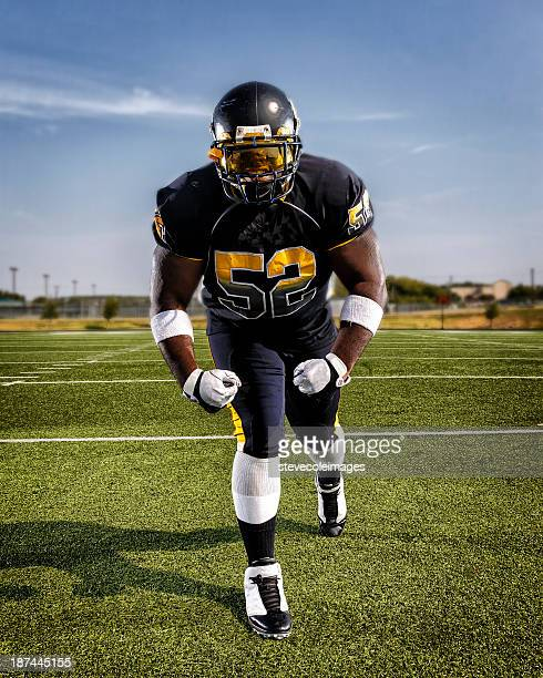 football player - charging sports stock photos and pictures