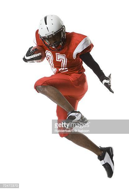 football player - halfback american football player stock pictures, royalty-free photos & images
