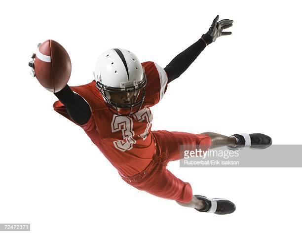 football player - wide receiver athlete stock pictures, royalty-free photos & images
