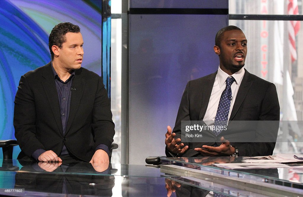 Football player Plaxico Burress (R) and penny stock expert Timothy Sykes visit 'Opening Bell With Maria Bartiromo' on the FOX Business Network at FOX Studios on March 10, 2015 in New York City.