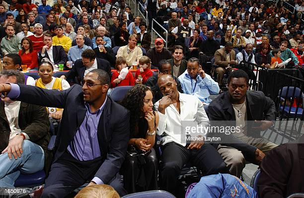 Football player Ray Lewis boxer Mike Tyson and football player LaVar Arrington attend the game between the Los Angeles Lakers and the Washington...
