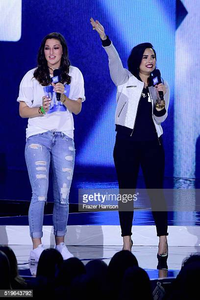 Football player Reilly Fox and singer Demi Lovato speak onstage at WE Day California 2016 at The Forum on April 7, 2016 in Inglewood, California.
