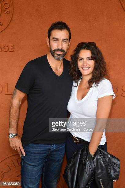 Football player Robert Pires and his wife Jessica attend the 2018 French Open Day Five at Roland Garros on May 31 2018 in Paris France