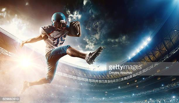 football player runs with the ball - football stockfoto's en -beelden