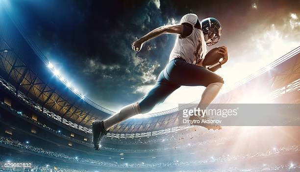 Football player runs with the ball