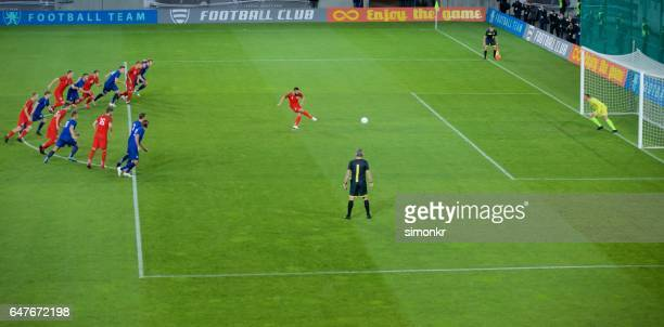 football player shooting - shootout stock pictures, royalty-free photos & images