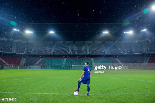football player standing in stadium - football strip stock pictures, royalty-free photos & images