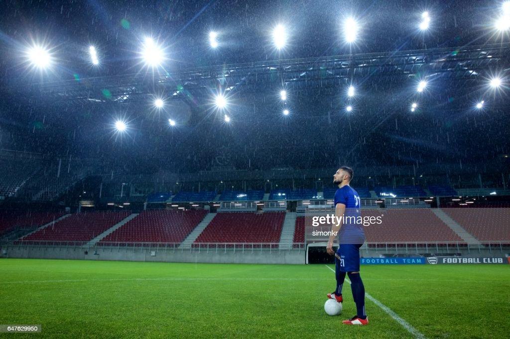 Football player standing in stadium : Stock Photo