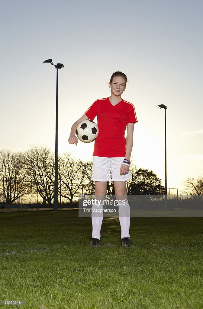 Football player standing with ball : Stock Photo