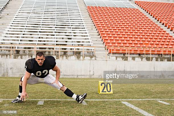 Football Player Stretching