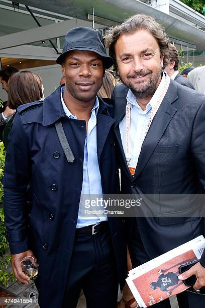 Football Player Sylvain Wiltord and Tennis Player Henri Leconte attend the 2015 Roland Garros French Tennis Open Day Five on May 28 2015 in Paris...
