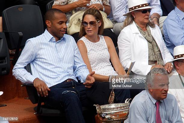 Football player Thierry Henry and his wife Nicole Merry attend the men's finals between Rafael Nadal and Roger Federer in the French Open at Rolland...