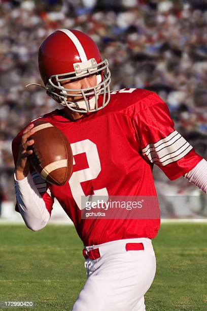 football player throwing a pass - quarterback stock photos and pictures