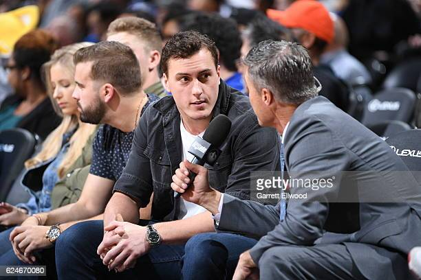 Football player Trevor Siemian of the Denver Broncos watches the game between the Denver Nuggets and the Golden State Warriors on November 10 2016 at...