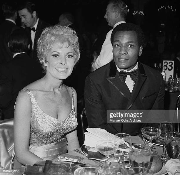 Football player turned actor Jim Brown with actress Janet Leigh attend an award dinner in Los Angeles California