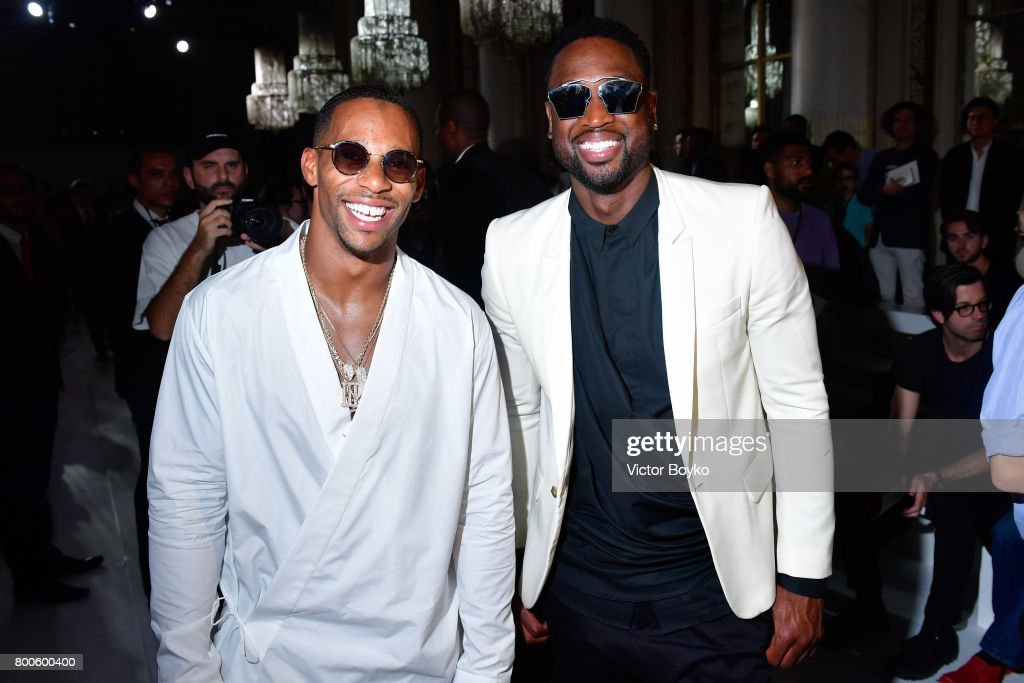 Football player Victor Cruz and basketball player Dwyane Wade attend the Balmain Menswear Spring/Summer 2018 show as part of Paris Fashion Week on June 24, 2017 in Paris, France.