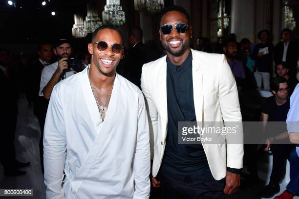 Football player Victor Cruz and basketball player Dwyane Wade attend the Balmain Menswear Spring/Summer 2018 show as part of Paris Fashion Week on...