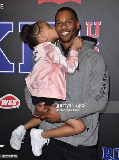 Football player Victor Cruz and daughter Kennedy Cruz attends ROOKIE USA Fashion Show at Milk Studios on February 15 2018 in Los Angeles California