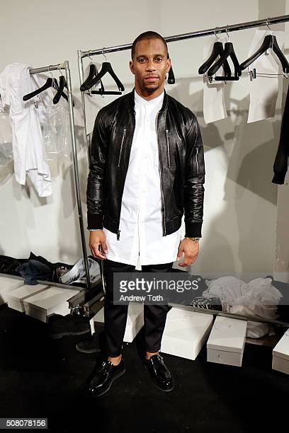 Football player Victor Cruz is seen backstage during Ovadia Sons New York Fashion Week Men's Fall/Winter 2016 at Skylight at Clarkson Sq on February...