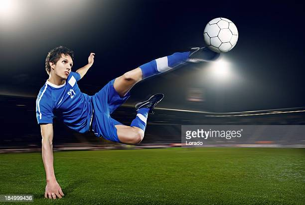 football player volleying ball - shooting at goal stock pictures, royalty-free photos & images