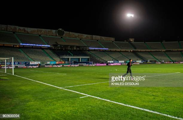 A football player warms up on the pitch prior to the Egyptian Premier League football match between AlAhly and Zamalek at the Cairo Stadium in the...