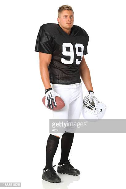 football player with a ball and helmet - safety american football player stock pictures, royalty-free photos & images