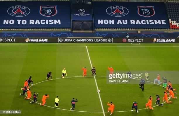 Football players and referees kneel on the pitch against racism before the UEFA Champions League group H football match between Paris Saint-Germain...