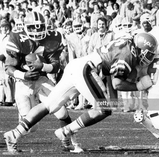 Football players are shown during a Maryland Terrapins football team representing the University of Maryland football game 1980