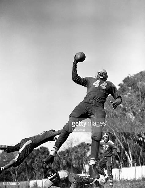Football players at BethuneCookman college during football practice Daytona Beach Florida January 1943