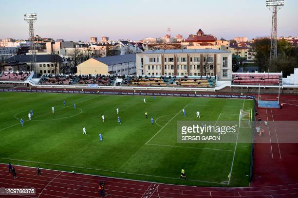 Football players attend the match of the Belarus Championship between FC DynamoBrest and FC Isloch in the town of Brest some 370 km southwest of...