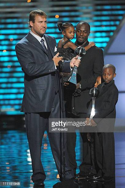 Football players Ben Rothlisberger Santonio Holmes and children onstage during the 17th annual ESPY Awards held at Nokia Theatre LA Live on July 15...