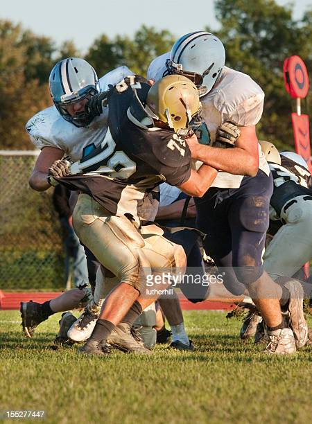 football players blocking an opponent