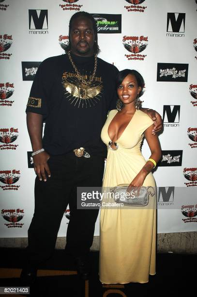 NFL football players Bryant McKinnie and Angel Lola Luv poses at the Swagga Entertainment and Dunk Ryder Records Presents Miami Stand Up 2008 at...