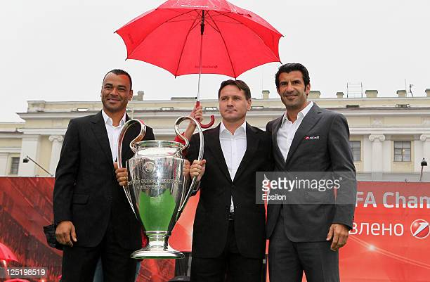 Football players Cafu Dmitri Alenichev Luis Figo with a Trophy before a press conference during the UEFA Champions League Trophy Tour 2011 on...