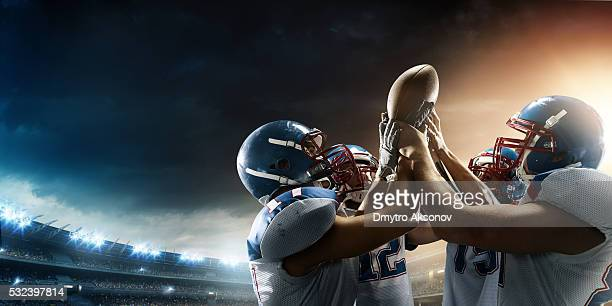 football players celebrate their victory - football stockfoto's en -beelden
