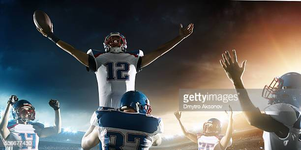 football players celebrate their victory - quarterback stock photos and pictures