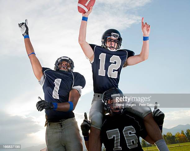 football players cheering in game - high school football stock pictures, royalty-free photos & images