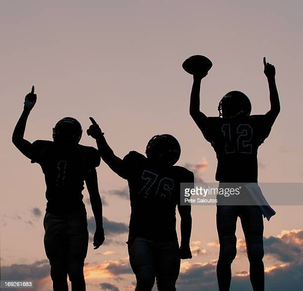football players cheering in game - safety american football player stock pictures, royalty-free photos & images