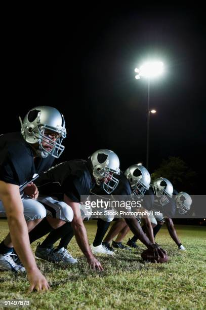 Football players crouching in a row