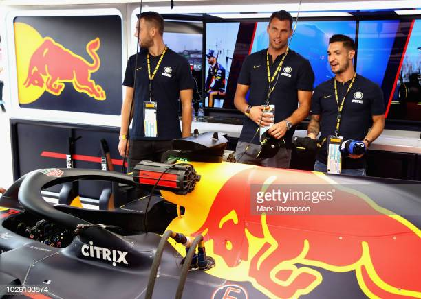 Football players Daniele Padelli Stefan de Vrij and Matteo Politano all of Inter Milan take a tour of the Red Bull Racing garage before the Formula...