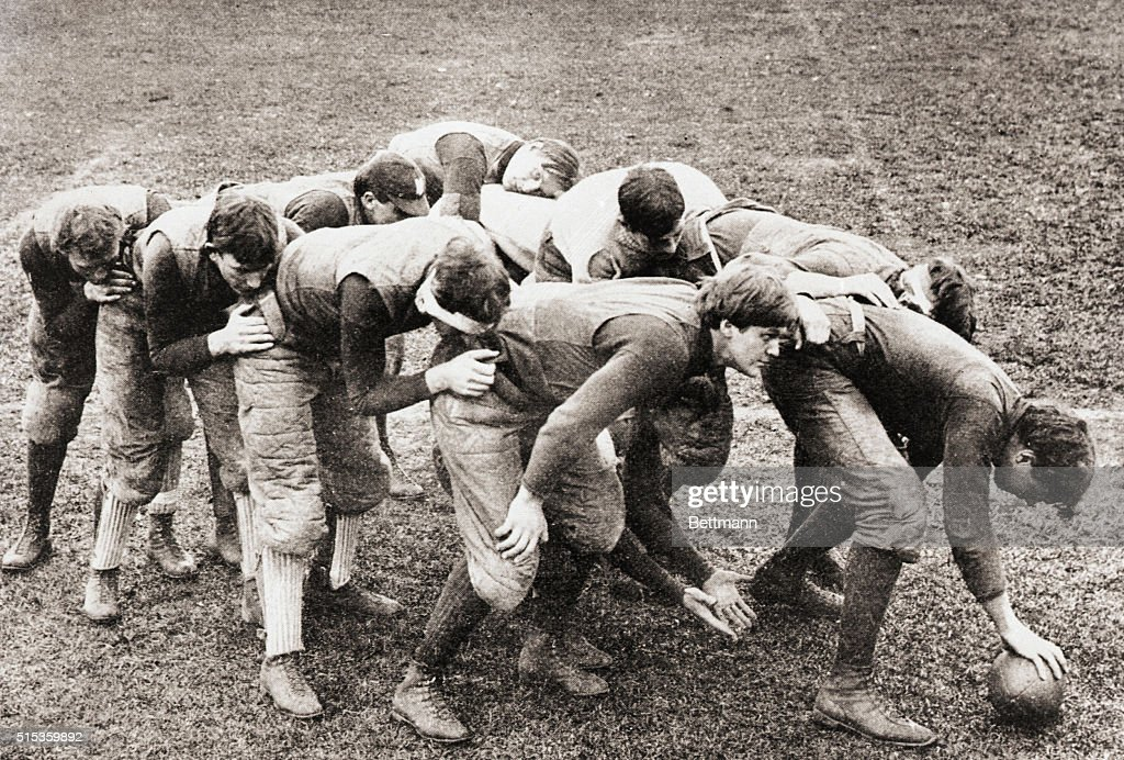 Football Players in Flying Wedge Formation : News Photo