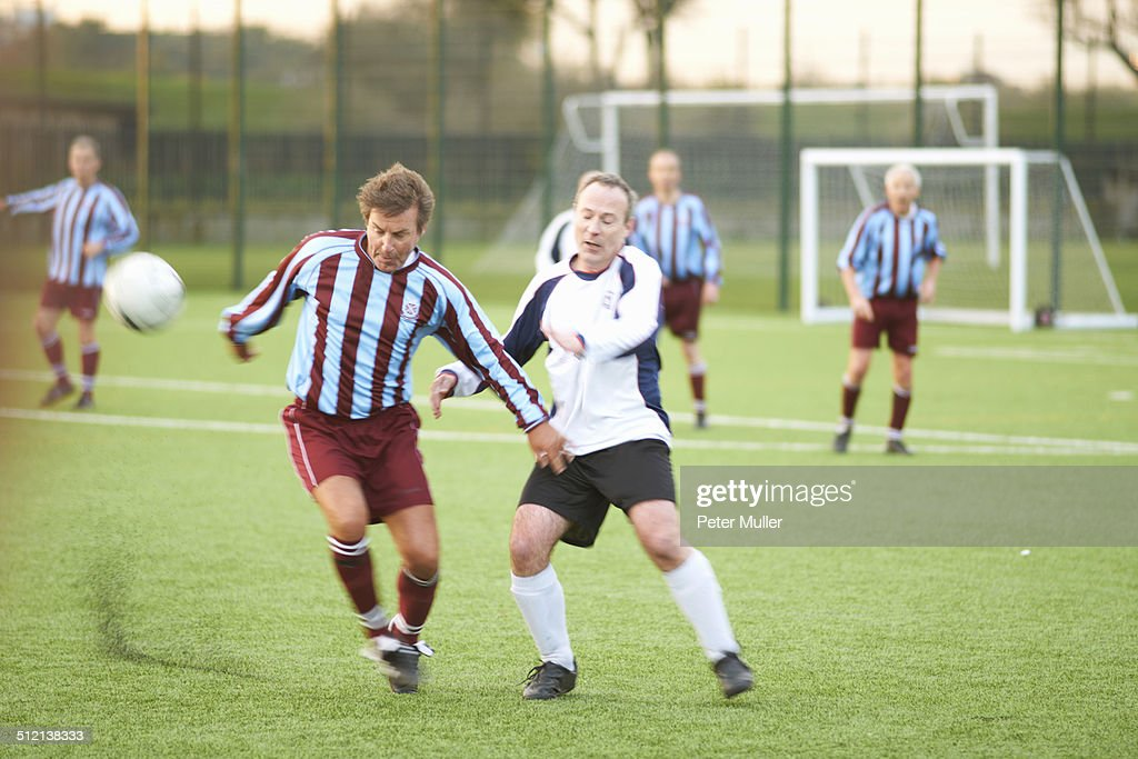 Football players fighting for ball : Stock Photo