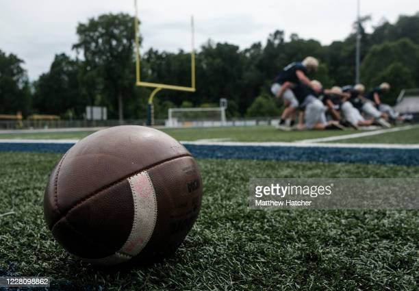 Football players from Lancaster High School run through drills and conditioning during football practice on August 18, 2020 in Lancaster, Ohio. Due...