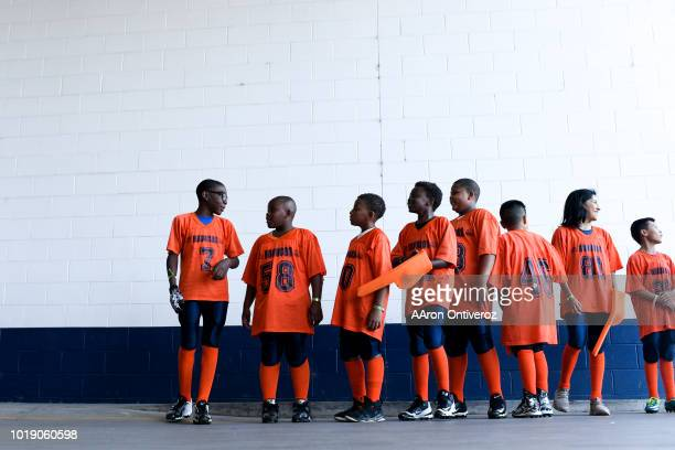 Football players from the Denver Boys and Girls Club prepare to enter the stadium before the first quarter between the Denver Broncos and the Chicago...