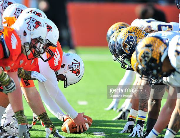 Football players from the Kent State Golden Flashes and Bowling Green Falcons line up for the snap of the ball on a field goal attempt during a game...